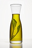 Sage oil in a carafe