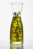Thyme oil in a carafe