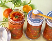 Tomato and herb sauce in screw top jars