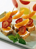 Skewered fruit on bread and jam for children