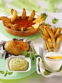 Potato wedges, chips and baked potato with dips