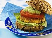 Fish burger with avocado paste
