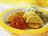 Breaded fish with spicy tomato sauce and herb rice
