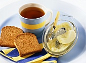 Tea, zwieback (rusk) and grated apple (light diet for children)
