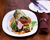 Pork fillet wrapped in savoy cabbage with mushroom sauce