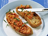 Toasted bread with tomato and lentil paste