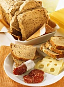 Wholemeal bread; pumpkin seed bread with salami and cheese