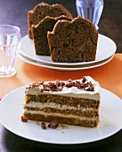 Piece of mocha cream cake, amaretti cake behind
