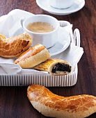 Mohnbeugel (poppy seed croissants) with coffee (Vienna, Austria)