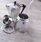 Making espresso: filling espresso pot with water
