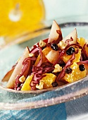 Raw red cabbage salad with plums and oranges