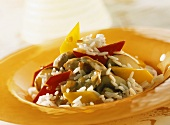 Pan-cooked rice dish with turkey, peppers and mushrooms
