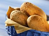 Yoghurt and walnut rolls in blue bread basket