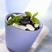 Blueberry sorbet with cream and mint