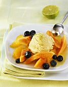 Lime ice cream with fruit salad