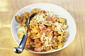 Pan-cooked noodle dish with ham, egg and cheese