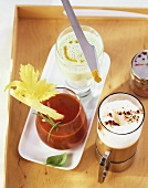 Cucumber kefir, tomato shake and coffee with milk froth