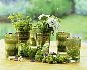 Tea glasses decorated with garden flowers and candles