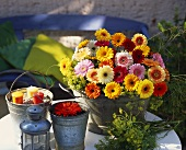 Table decoration with zinc pails, candles and gerberas
