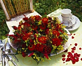 Arrangement of zinnias, roses, lady's mantle etc.