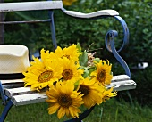 Sunflowers on a garden chair