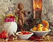 Autumnal decoration with ornamental gourds, rose hips & dahlias
