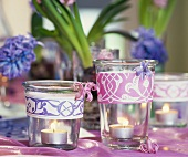 Table decoration of burning tea lights and hyacinths