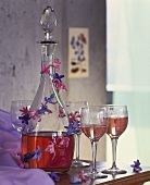Rosé wine in glass carafe with garland of hyacinths