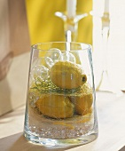 Table decoration of lemons in glass container