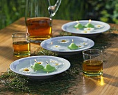 Plates with floating candles and marguerites on grass