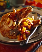 Pork chop with onion and peach ragout