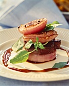 Beef tournedos on red onions