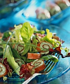 Salmon rolls with mixed salad leaves