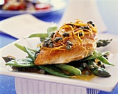 Chicken fillet with capers and lemon zest on bed of vegetables