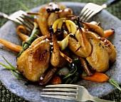 Glazed quails on bed of vegetables