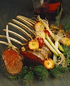 Rack of lamb with apples and leeks on fir branches