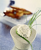 Portion of soft cheese with chives