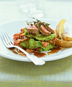 Lamb fillet on pea puree with bacon and balsamic sauce