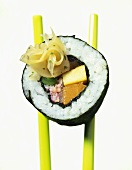 Maki-sushi with crabmeat, carrot, scrambled egg, tuna, bean
