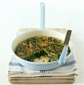 Spinach frittata in round baking dish