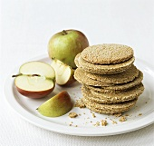 Oatmeal biscuits (low-fat) and apples on a plate