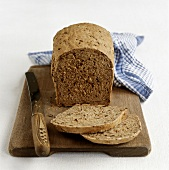Wholemeal bread, slices cut on a wooden board