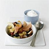 Fruit salad with green tea, low-fat yoghurt behind