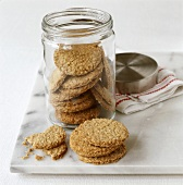 Ginger oat biscuits in and beside jar