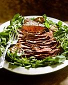 Roast beef with caramelised lemon slices on rocket salad