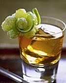 Whiskey cooler in glass, garnished with grapes