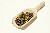 Wellness tea mixture in a wooden scoop