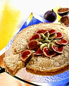 Almond cake with kiwi fruit and figs