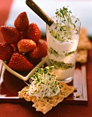 Sprout salad, crispbread with topping and strawberries