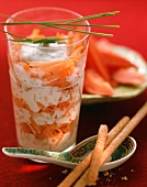Carrot salad with yoghurt in glass, papaya in background